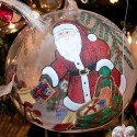 This large hand-blown glass ball from Poland depicts Santa with his bag of toys and rotates to a hobby horse waiting under the Christmas tree with a toy bear and other presents. Half the ball is clear and half frosted, giving the illusion of peeking through a window – the kind of effect that delights a child. Photo by Pete Paterson.