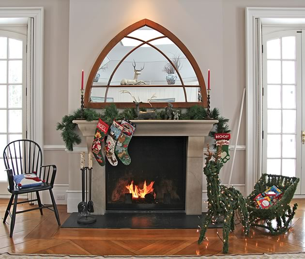 The Gothic-style mirror is in perfect proportion to the fireplace and in keeping with the season.