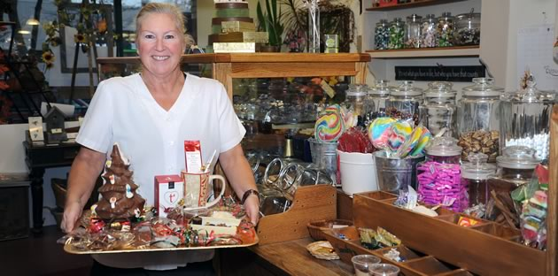 """Barb Chafey shows off a tray of seasonal treats in her Orangeville store: """"It's a happy business."""" Photo by Rosemary Hasner / Black Dog Creative Arts."""