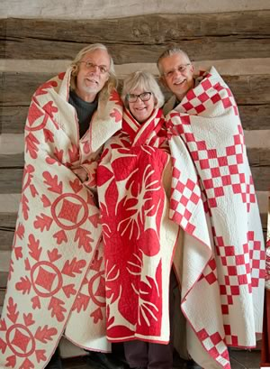Wearing their story on their backs, author Shelagh Roberts (in Cockscomb) is fl anked by quilt photographer Pete Paterson (in Oak Leaf and Reel) and archivist Steve Brown. The Double Irish Chain quilt Steve is wearing was made by his grandmother. Now in the museum's collection, it is one of the 63 quilts featured in The Quilts of Dufferin County. Photo by Pete Paterson.