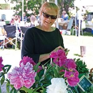 Shopper Sybil Walker surveys the produce at Orangeville Farmers' Market.