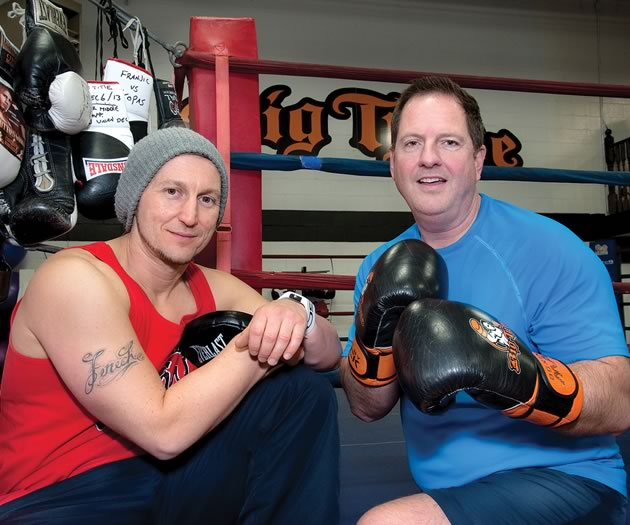 Trainer Tony Fenech has been putting Orangeville mayor Rob Adams through his paces for about four years, usually in the gym at Big Tyme Fitness and Boxing, but sometimes for variety on the playground equipment of a local school. Photo by Rosemary Hasner / Black Dog Creative Arts.