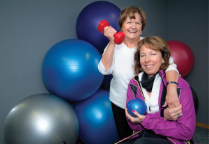 "Nancy Frater (left) practises cardio and strength exercises with Terri Holden, whom she affectionately calls ""the princess of pain."" Photo by Rosemary Hasner / Black Dog Creative Arts."