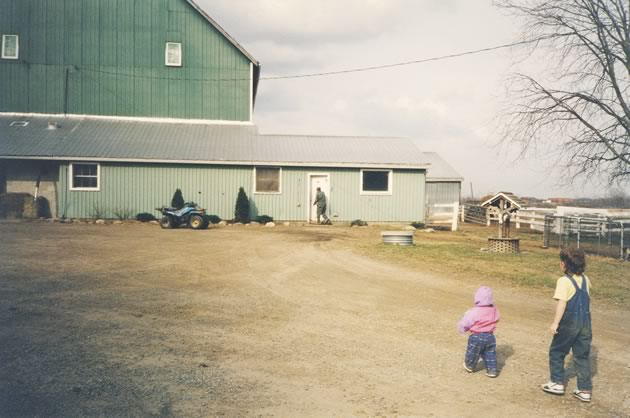 The writer's grandfather steps into the milk house on a long-ago spring day, while his siblings look on.