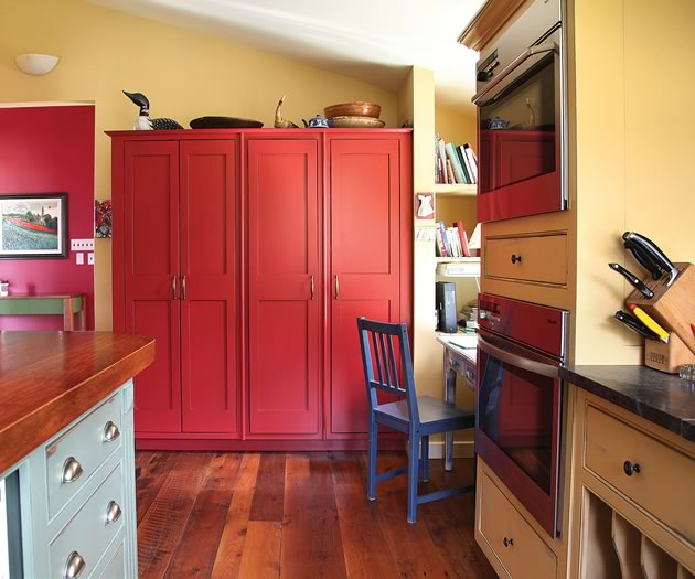 The kitchen design was influenced by the eclectic kitchens of rural southern France. Freestanding cupboards and colourful furnishings make it a lively centre for cooking and conversation. Photo by Pam Purves.
