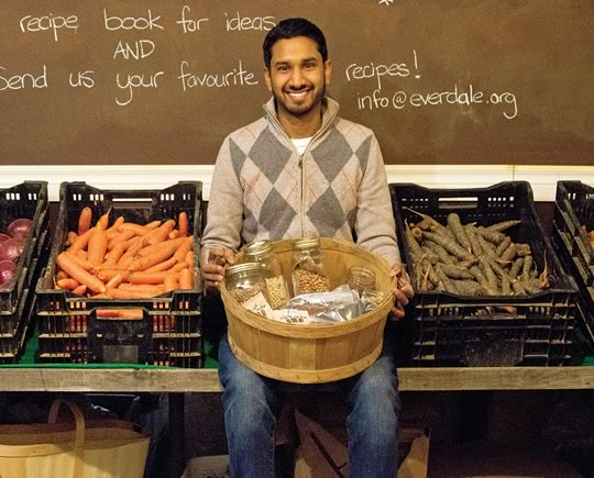 Aabir Dey with a basket of organic seeds from the Everdale Farm seed library. The vegetables on the counter are from the farm's fall harvest, stored through the winter in its cold cellar. According to the United Nations, the world has lost 75 per cent of the genetic diversity of food crops since 1900. Photo by Pete Paterson.
