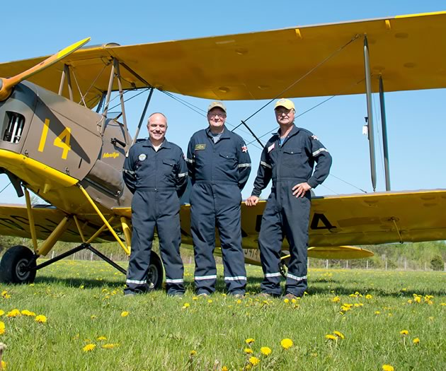 Mike Dennett, Andy Scott and Danny Garyfalakis with their Tiger Moth, the culmination of two years of meticulous restoration work. Photo by Pete Paterson.