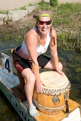 Team member Anne Cooper-Worsnop at the drummer's post in the bow of the boat. Photo by Pete Paterson.