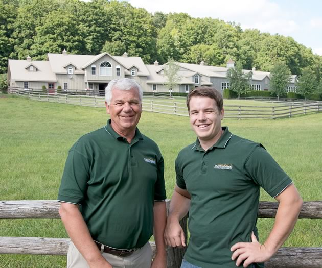 Father and son: Gary and Greg van Bolderen, next to a stable complex built by Dutch Masters near Inglewood. Photo by Pete Paterson.