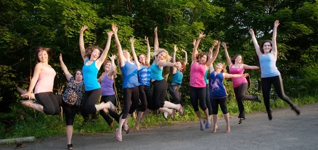 Members of the EQ Collective jump for joy! left to right : Andrea D'Errico, Karen Stuckey, Kim Ellis, Heidi Allen, Natalie Grist, Jennifer Bailey, Jenee Gowing, Sonya Nagels, Jenene Chung, Alicia Cooper, Faith Flatt, Johanna Bernhardt, Julia Rowe. not pictured : Ally Buchan, Cecile Thomas. Photo by Rosemary Hasner / Black Dog Creative Arts.