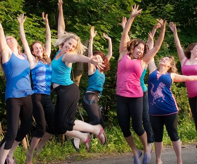 Members of the EQ Collective jump for joy! Photo by Rosemary Hasner / Black Dog Creative Arts.