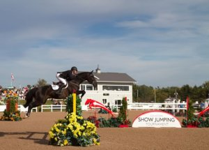 Chris Sorensen of Caledon East executes a picture-perfect jump at the recent Canadian Show Jumping Tournament at Caledon Equestrian Park. Photo by Ellen Cameron.