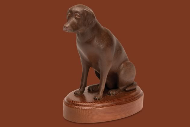 "Jake (a chocolate lab), basswood, 6 ½"" (excluding base). Photo by Pete Paterson."
