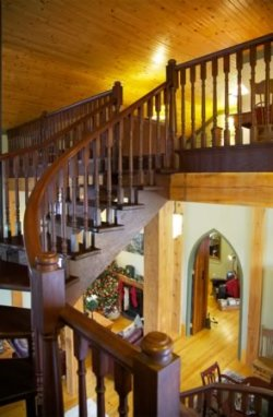 The master bedroom in the loft sits right under the eaves. Photo by Pam Purves.