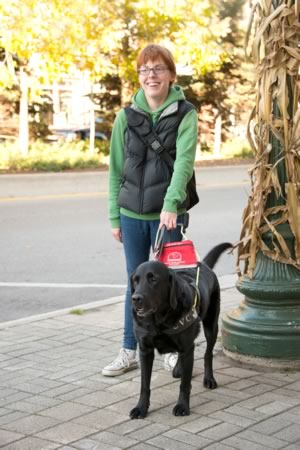 Laura Jotham with Watson at work in downtown Orangeville. Photo by Pete Paterson.