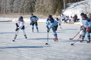 In 2013, Alton women's team Group Therapy (in white) matched skills against the women's team from Inglewood (in blue). Photo by Joanne Crease.