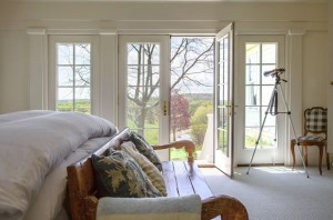 The master bedroom opens onto long views of bucolic countryside. Photo by Pam Purves.