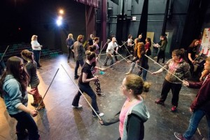 "Students at Erin District High School practise battle choreography for this spring's production of The Lion, the Witch and the Wardrobe under the guidance of drama teacher Stephen Sherry. ""The arts are underestimated in what they do for students,"" he says. Photo by Pete Paterson."