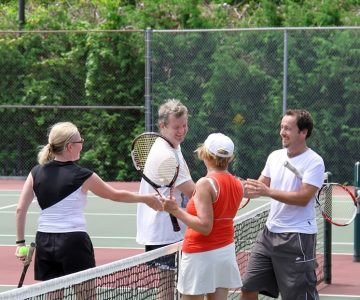 Andrea and Dave Adsetts (left) congratulate Carol Hall and Dennis Beentjes at a recent 95+ tournament on Mono Centre courts. Photo by Jason Hall.