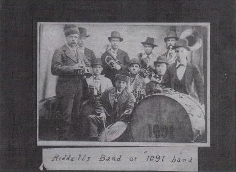 Another side of W.H. Riddell: Riddell, in the homburg, far right, was the conductor of the 1691 Band, also known as Riddell's Band, as shown in this photo, ca 1870, from the Dufferin archives.