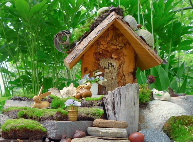 It's fun to explore yards and woods for your own pretty stones, mosses, acorns, pine cones, twigs, bark and other natural building materials. Photo by Signe Ball.