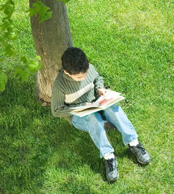 Read under a tree In your backyard, parks and conservation areas