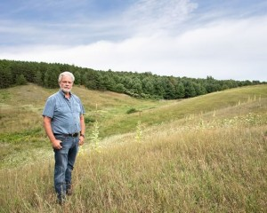 Sheep farmer Doug Cox says filling the gullies on his property to increase his herd and improve his profits is a normal farm practice. But in the absence of regulatory oversight, neighbours fear soil and water contamination. Photo by Pete Paterson.