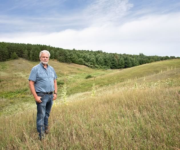 When you look across Doug Cox's farm from the corner of Mono Centre Road and 5th Line, all you see are gently rolling green fields, not the two gullies hiding in the back corner of the property. Photo by Pete Paterson.