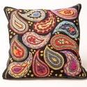 Warm up your chesterfield or reading nook with this paisley pillow made from a hand-hooked rug by fibre artist Martina Lesar in her log cabin studio in the Caledon hills.