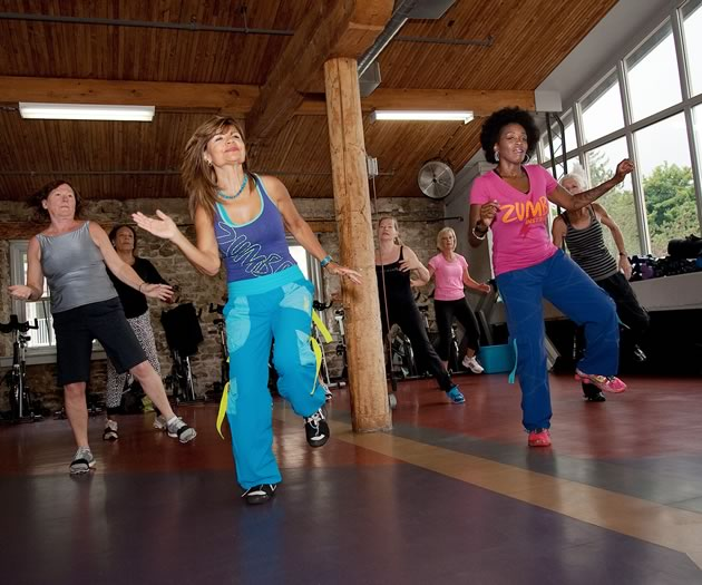 Ivonne Ibarra (left) leads Zumba classes at Riverdale Fitness Mill. She mentored Janice M-Eisenberg (right) who now leads classes at Caledon Centre for Recreation and Wellness. Photo by Rosemary Hasner / Black Dog Creative Arts.