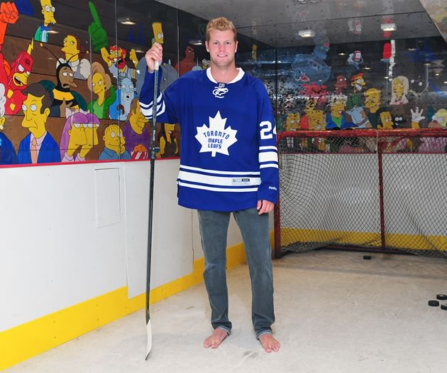 When he was 14, Holland's parents installed a shooting area in a corner of the basement, complete with hockey boards and Plexiglas to protect the walls, and simulated ice on the floor. They even hired an artist to draw a crowd of The Simpsons characters, along with a few familiar hockey faces, who watched their son shoot. Photo by James Jackson.