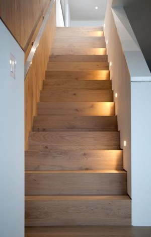 Oak stairs lead to a bright and roomy basement. Photo by Pam Purves.