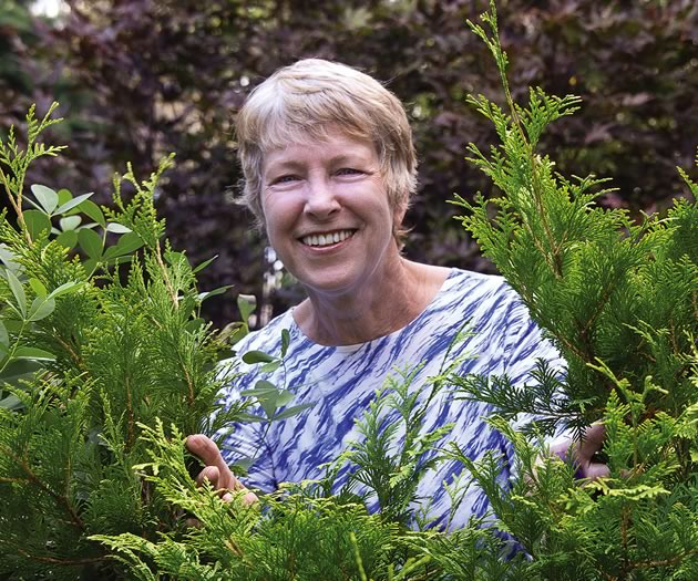 Lynn Sinclair-Smith tends the Friendship Gardens. Photo by Pete Paterson.