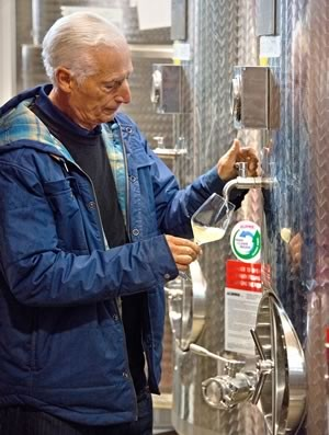 Mario Adamo samples a wine-in-progress. Photo by Pete Paterson.