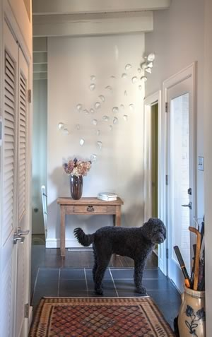 The 12- foot ceiling in the hallway designates this as public space where noisy greetings are enjoyed. Photo by Pam Purves.