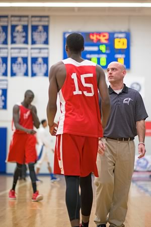 Brandon Lesovsky coaches guard Tyrell Leotaud as Athlete Institute Prep starts to take over the game against Father Henry Carr. Photo by James MacDonald.