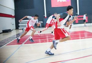 Jaelin Llewellyn of Orangeville Prep runs through after-school drills with his fellow students. Photo by James MacDonald.