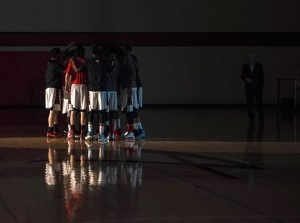 Professional players from the Orangeville A's huddle before the tip off of a home game against the London Lightning on January 16. Photo by James MacDonald.