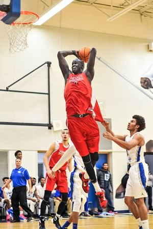 Thon Maker of Athlete Institute Prep is fouled while going up for a dunk against the Father Henry Carr basketball team in Etobicoke last fall. Photo by James MacDonald.