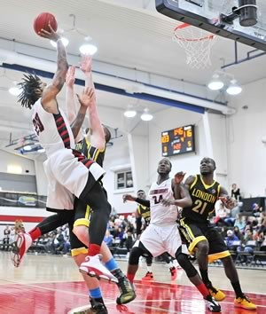 Orangeville A's power forward Justin Moss goes up for a shot in the game against the London Lightning, while his teammate, power forward Flenard Whitfield, jostles for the rebound. Photo by James MacDonald.