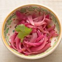 In a sauce pot, mix pickling spice, garlic, sugar, water and red wine vinegar. Bring to a boil. Remove from heat. Let cool for 5 minutes. Place red onions in a dish and pour pickling liquid over until just covered. Set the dish in the fridge for 10 minutes. Photo by Pete Paterson. Styling by Jane Fellows.