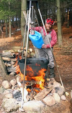 Kevin Brunner boils down maple sap the traditional way at Beaverwood Farm. Photo by Don Scallen.