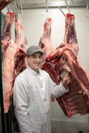 Head butcher Jason Cooney in the hanging room. Photo by Pete Paterson.