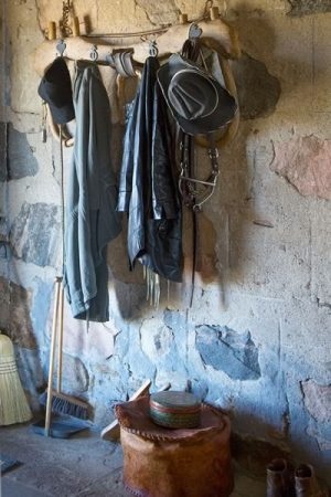 The original stone wall is a rugged backdrop to outdoor wear. Photo by Pam Purves.
