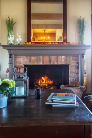 The fireplace is the focal point for gatherings in the new addition. Photo by Pam Purves.