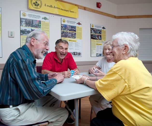 Marg Patterson (right) shares a laugh with fellow poker players. Photo by Rosemary Hasner / Black Dog Creative Arts.