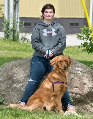 At Humberview, Hanna shares a moment with her training partner Brandy. Photo by Pete Paterson.