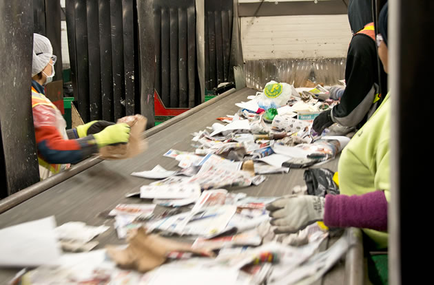 The Peel sorting station relies on both mechanized systems and workers who separate paper, plastics and metals from a single stream of items. Photo by Pete Paterson.