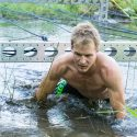 Ryan Atkins plows through a water obstacle. Photos by Fred Webster.