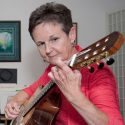 Lorraine McNally practises on the guitar made by her music teacher Daniel LaBrash. Photo by Rosemary Hasner / Black Dog Creative Arts.